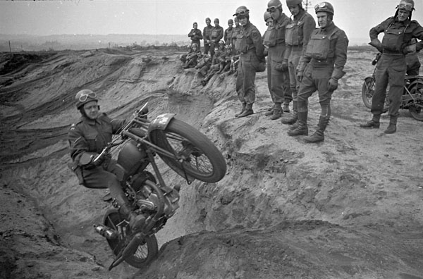 A trainee riding a Norton motorcycle during a despatch riders training course, Bordon, England on May 1, 1942. Photo credit: Lieut. George A. Cooper / Canada. Dept. of National Defence / Library and Archives Canada / PA-160020