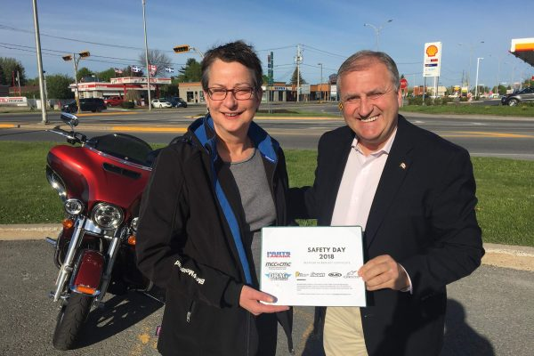 MP Jean-Claude Poissant presenting Motorcyclists Making a Difference certificate to 2nd place winner Helene Boyer.