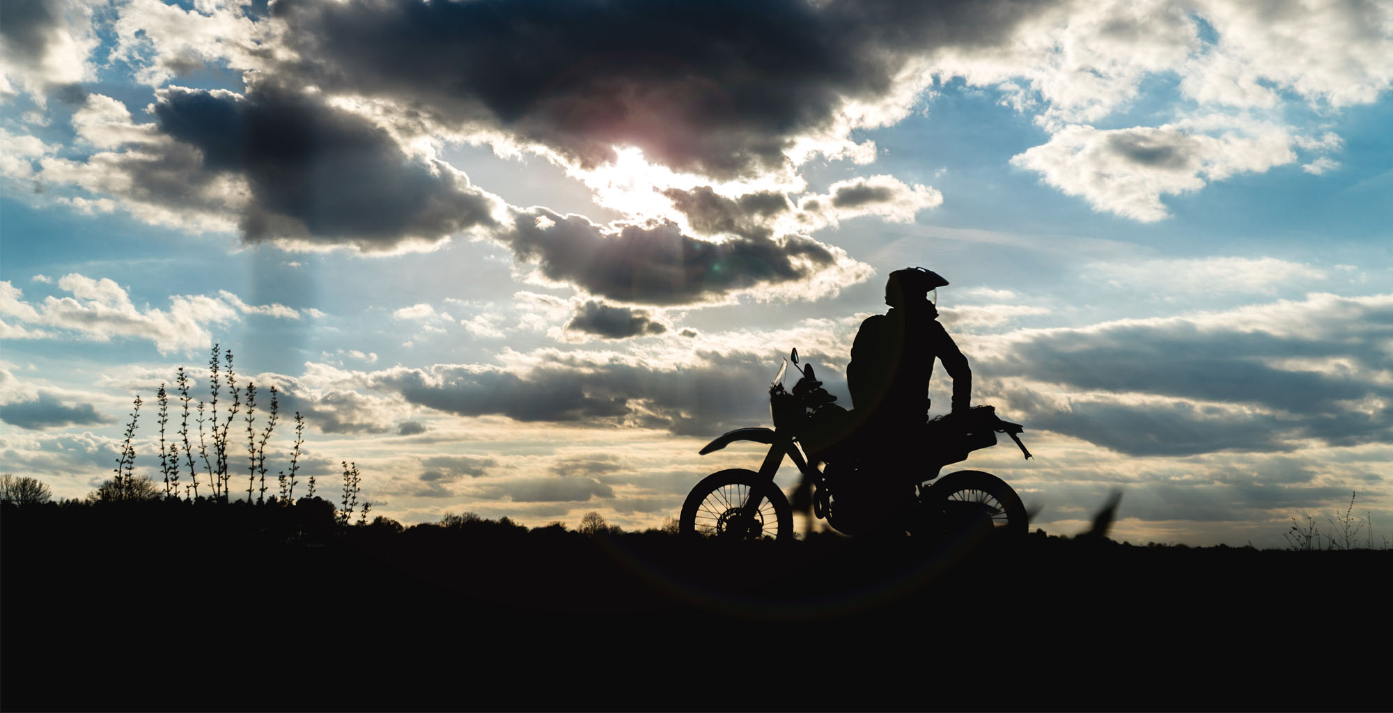 Message from Chris Bourque MCC Board Chair, image of a motorcycle rider in silhouette