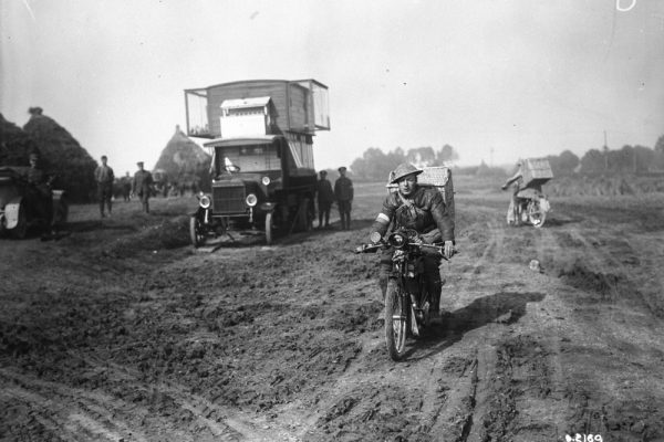 (His Majesty's Pigeon Service) Despatch Rider with pigeons leaving for firing line. November 1917. Photo credit: Canada. Dept. of National Defence / Library and Archives Canada.