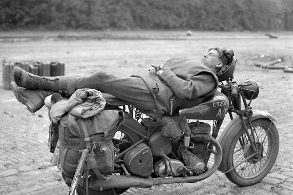 Private L. Wilkins of the Essex Regiment resting on his motorcycle. Photo credit: Canada. Dept. of National Defence /Library and Archives Canada.