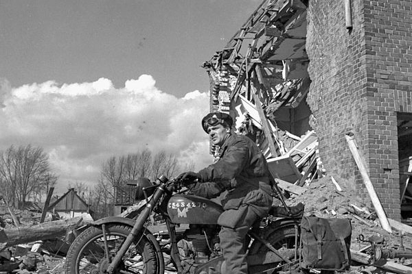 Lieutenant G. Murray Williams of Headquarters Company, 1st Canadian Parachute Battalion, riding a Norton Model 1G-H motorcycle during the battalion's advance from Lembeck through Coesfeld, Germany, on March 30, 1945. Photo credit: Lieut. Charles H. Richer / Canada. Dept. of National Defence / Library and Archives Canada / PA-206876