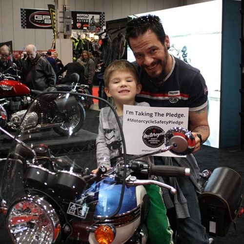 Dad and son on motorcycle